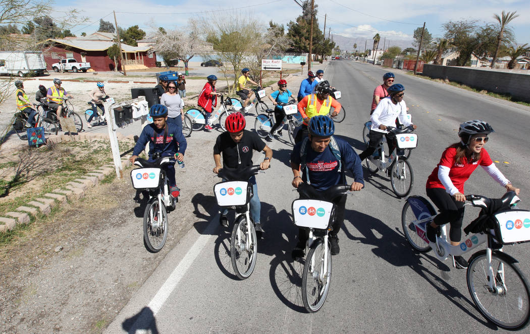 Cyclists depart Vegas Roots Community Garden on Tonopah Drive near Bonanza Road Monday, March 12, 2018, during a bike ride through historic West Las Vegas. The ride, which included students from L ...
