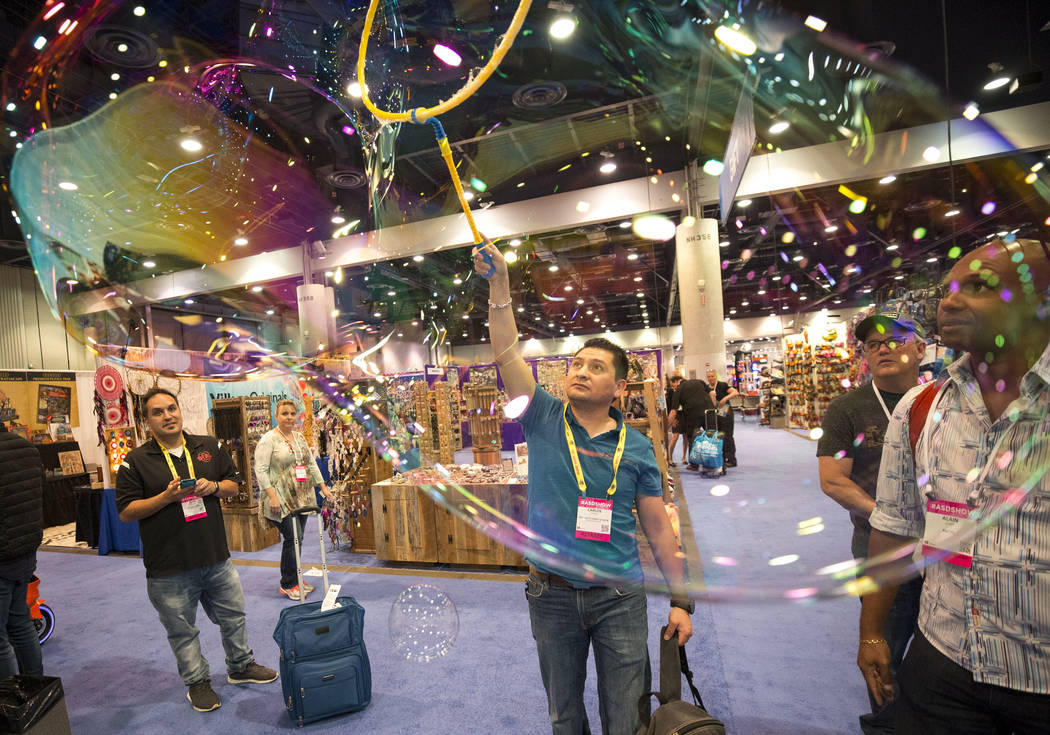 Henderson resident Carlos Torres demos the Mega Loop bubble maker at the Uncle Bubble booth during the ASD Market Week Trade Show at the Las Vegas Convention Center on Sunday, March 11, 2018. Rich ...