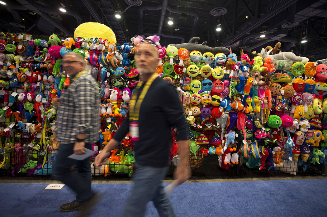 Attendees walk past a wall of stuffed animals at the Goffa Internation Corporation booth during the ASD Market Week Trade Show at the Las Vegas Convention Center on Sunday, March 11, 2018. Richard ...