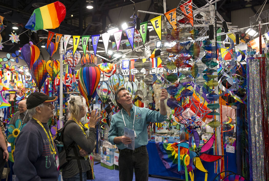 Billy Jones, of In the Breeze LLC, right, helps customers at his booth during the ASD Market Week Trade Show at the Las Vegas Convention Center on Sunday, March 11, 2018. Richard Brian Las Vegas R ...