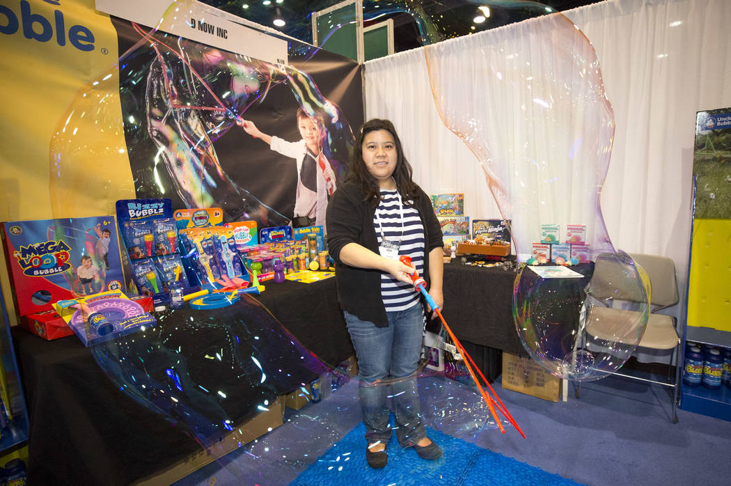Uncle Bubble toy company CEO Vicky Lin demos the Mega Loop bubble maker at her booth during the ASD Market Week Trade Show at the Las Vegas Convention Center on Sunday, March 11, 2018. Richard Bri ...