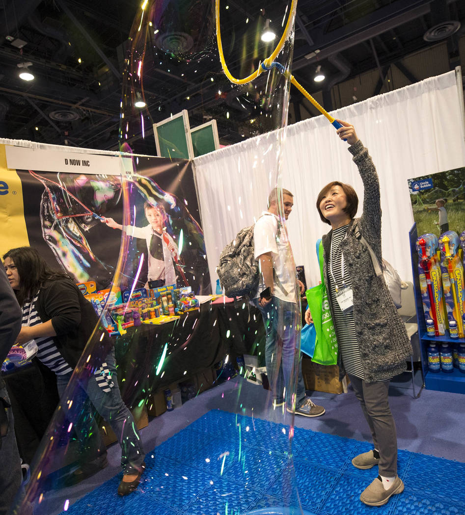 Liz Han of California demos the Mega Loop bubble maker at the Uncle Bubble booth during the ASD Market Week Trade Show at the Las Vegas Convention Center on Sunday, March 11, 2018. Richard Brian L ...