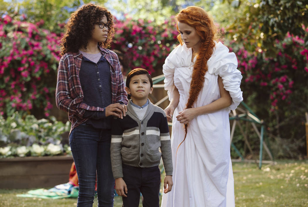 """Storm Reid, from left, Deric McCabe and Reese Witherspoon in a scene from """"A Wrinkle In Time."""" (Atsushi Nishijima/Disney via AP)"""