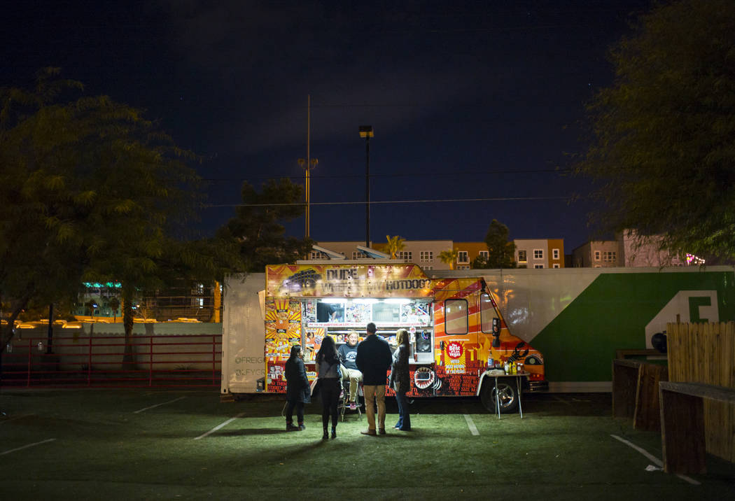 Attendees get snacks from a food truck at Bunkhouse Saloon during the second night of the Neon Reverb music festival in downtown Las Vegas on Saturday, March 10, 2018. Chase Stevens Las Vegas Revi ...