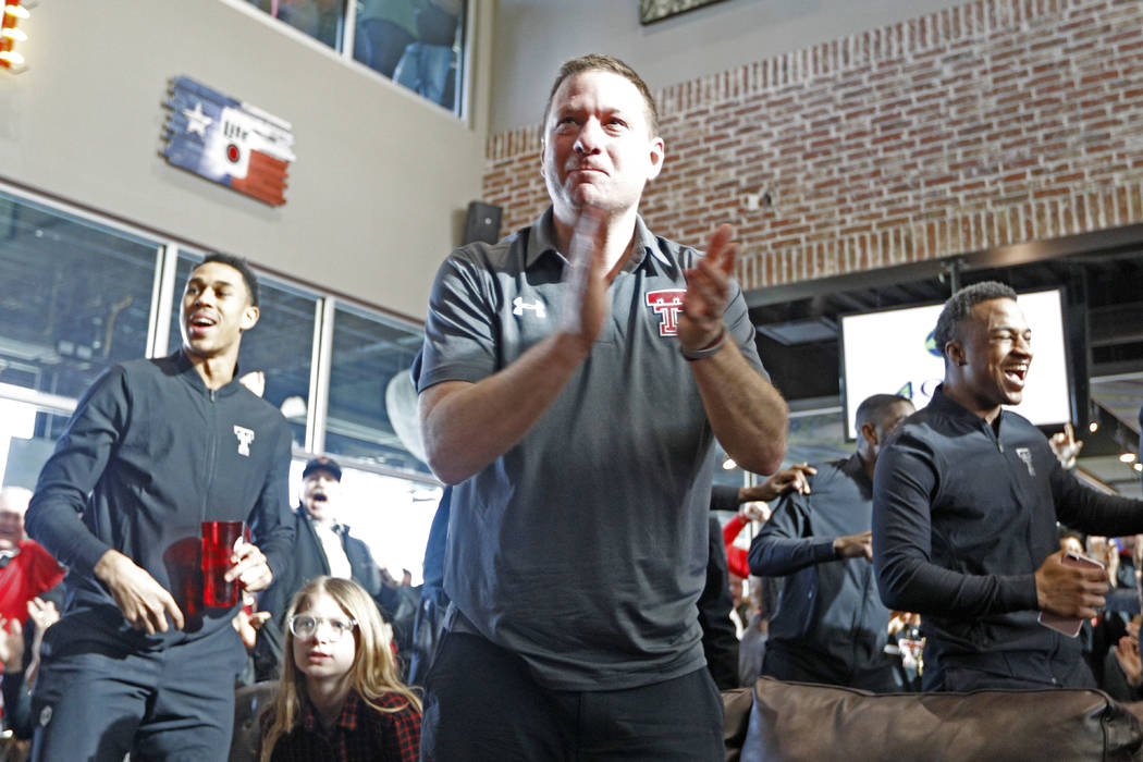 Texas Tech coach Chris Beard celebrates after finding out where the Red Raiders will play during a watch party for the NCAA basketball tournament Sunday, March 11, 2018, in Lubbock, Texas. (Brad T ...