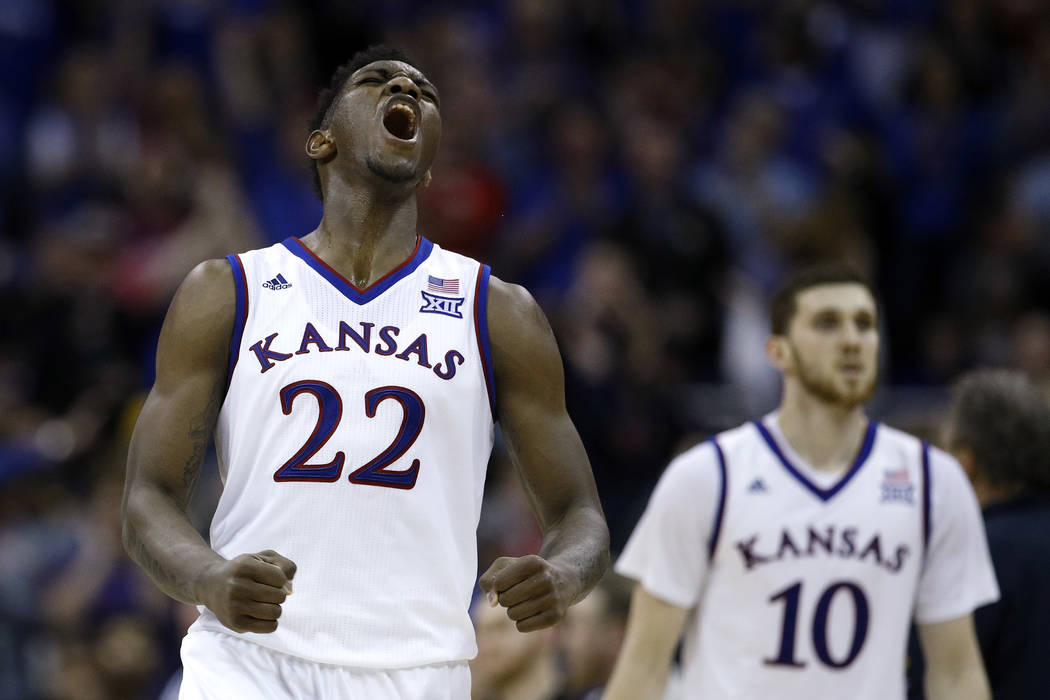Kansas' Silvio De Sousa (22) celebrates during the second half of the NCAA college basketball championship game against West Virginia in the Big 12 men's tournament Saturday, March 10, 2018, in Ka ...