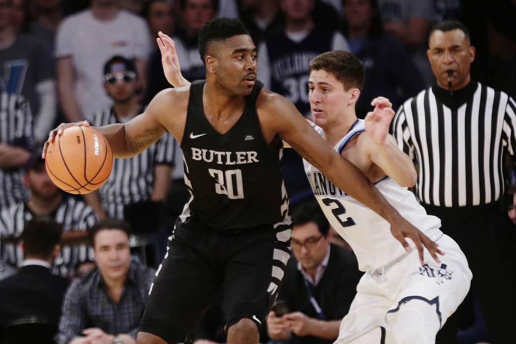 Villanova's Collin Gillespie (2) defends Butler's Kelan Martin (30) during the first half of an NCAA college basketball game in the Big East men's tournament semifinals Friday, March 9, 2018, in N ...