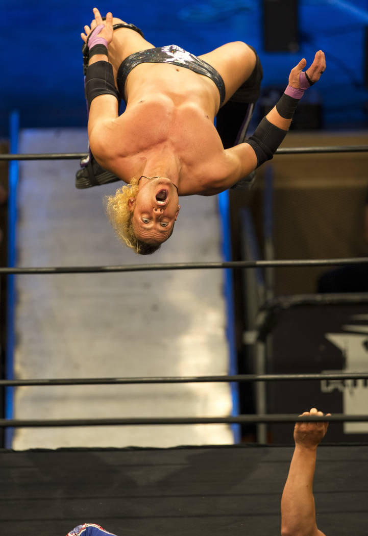 Matt Taven jumps onto Cody during the Ring of Honor World wrestling match at the Sam's Town Hotel and Gambling Hall in Las Vegas on Friday, March 9, 2018. Richard Brian Las Vegas Review-Journal @v ...