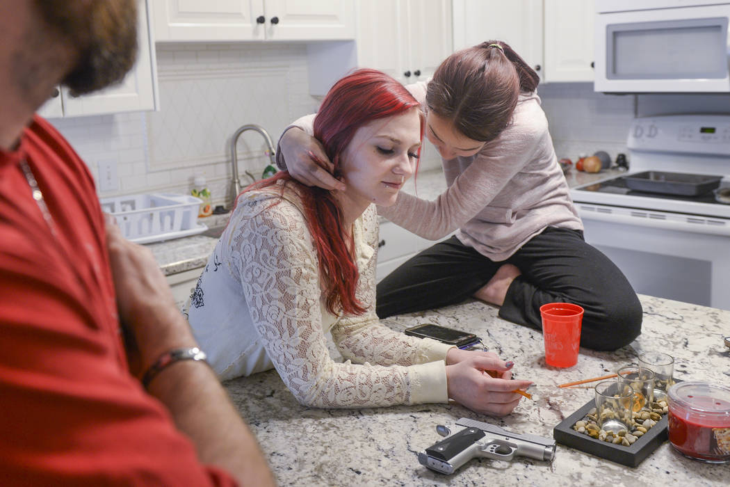 Jacee Cole, 20, said a stalking incident in a store as a teenager spurred her to get her concealed carry permit when she was 19 years-old for self defense. Cole, shown at home in West Jordan, Utah ...
