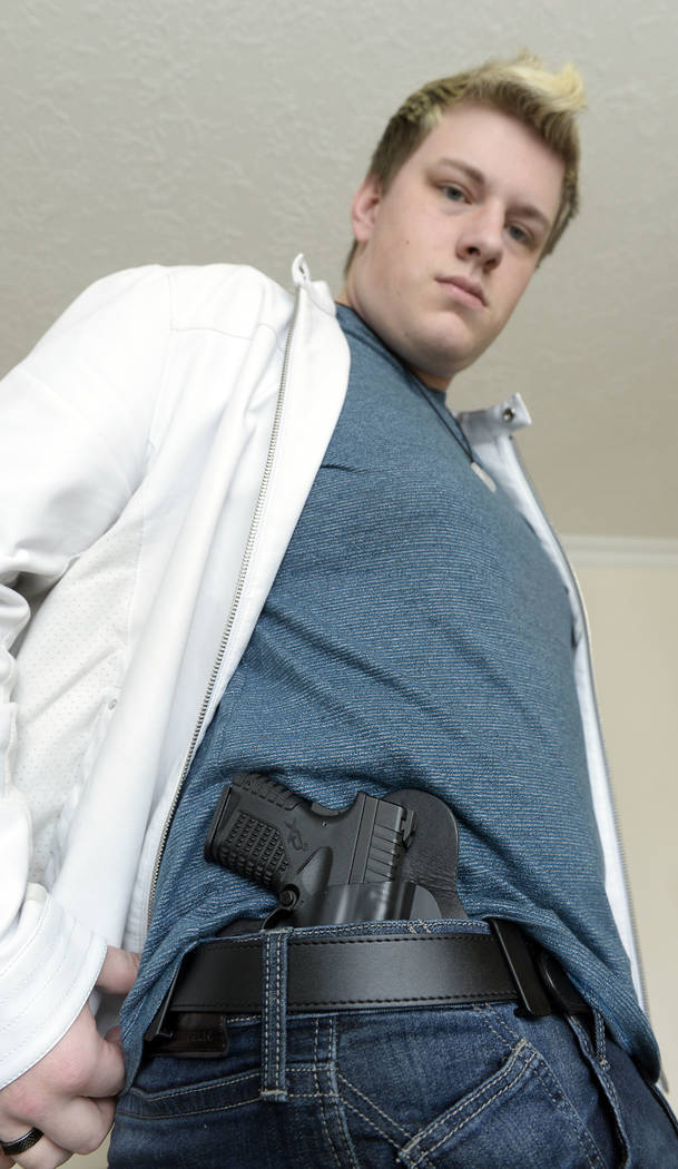 Twenty-year-old Jared Larson, carries a concealed firearm with a new provisional state permit. Larson pictured on March 1, 2018 in his Centerville, Utah, home. (Al Hartmann/The Salt Lake Tribune v ...