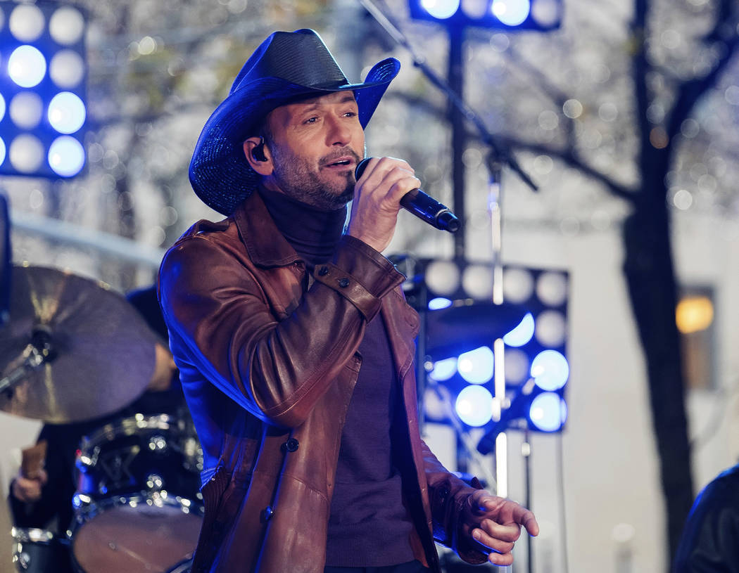 """FILE - In this Nov. 17, 2017, file photo, Tim McGraw performs on NBC's """"Today"""" show at Rockefeller Plaza in New York. McGraw collapsed onstage during a performance in Dublin, Ireland, Su ..."""