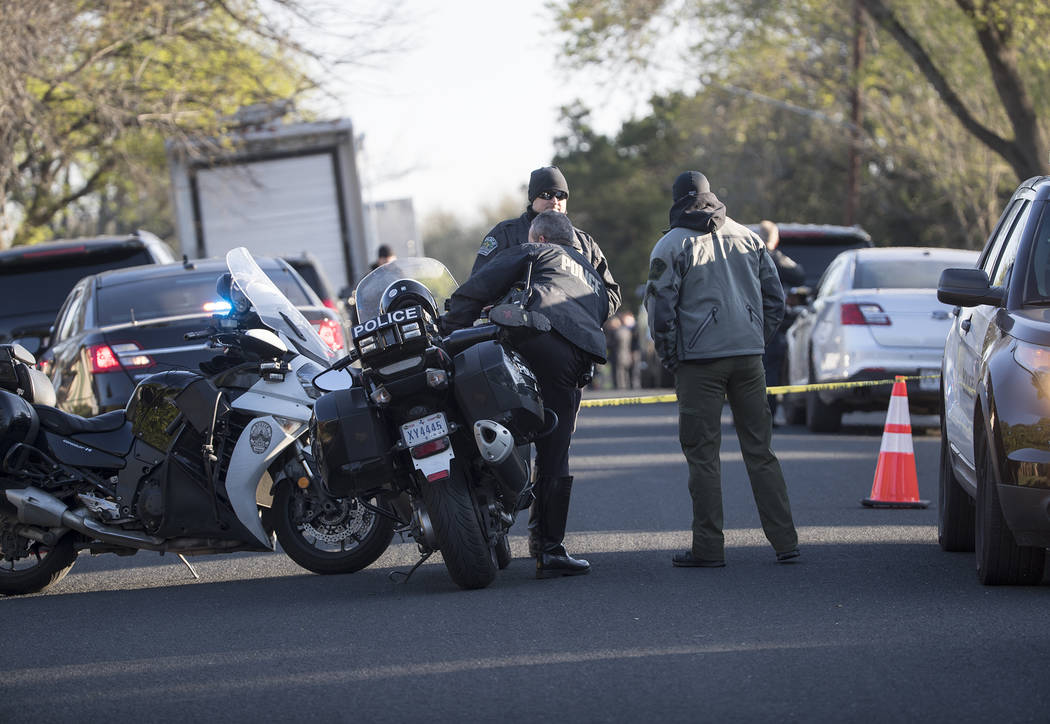 Authorities are investigating the scene in East Austin, Texas, after a teenager was killed and a woman was injured in the second Austin package explosion in the past two weeks Monday, March 12, 20 ...