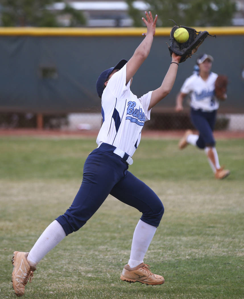 Centennial's Samantha Lawrence (10) catches a fly ball to get out Faith Lutheran's Sophie Foster, not pictured, during a softball game at Faith Lutheran in Las Vegas on Tuesday, March 13, 2018. Ce ...