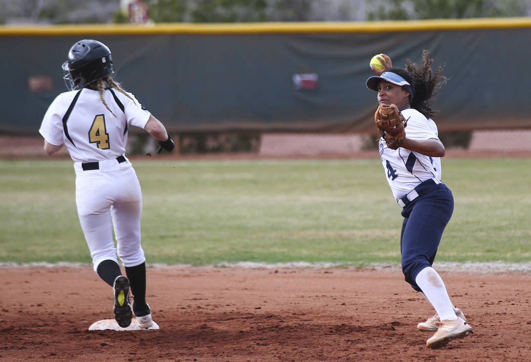 Centennial's Kiana Tate (4) throws to first base after getting out Faith Lutheran's Grace Hornsby (4) at second during a softball game at Faith Lutheran in Las Vegas on Tuesday, March 13, 2018. Ce ...