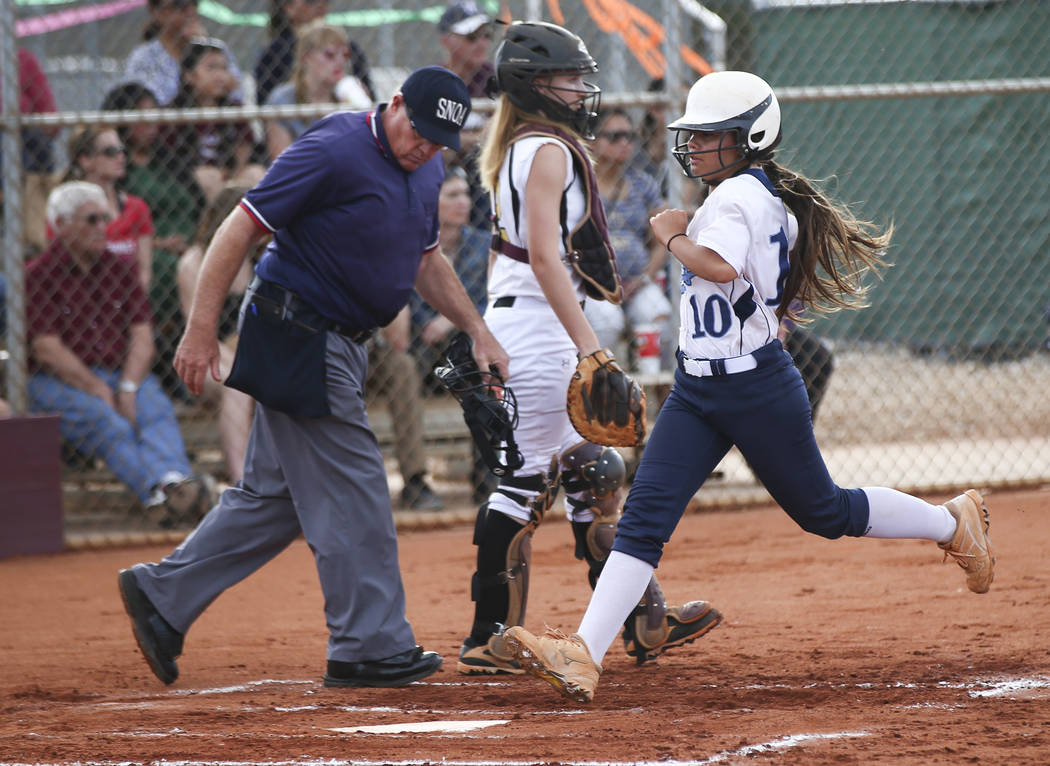 Centennial's Samantha Lawrence (10) scores a run past Faith Lutheran's Ellie Fried (12) during a softball game at Faith Lutheran in Las Vegas on Tuesday, March 13, 2018. Centennial won 14-1. Chase ...