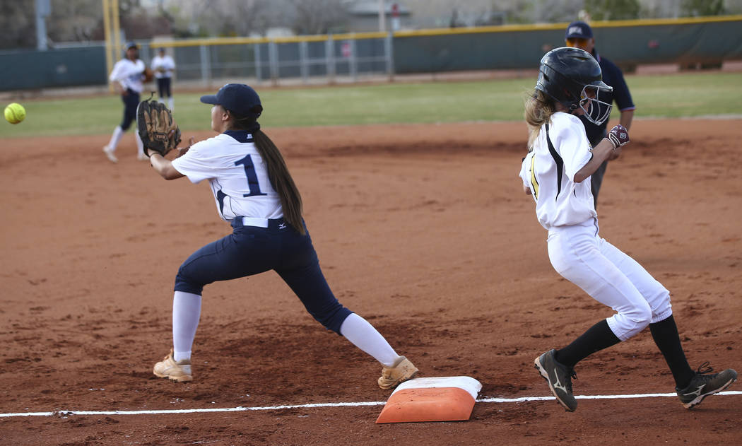 Faith Lutheran's Natalie Behmer (7) makes it to first base against Centennial's Samantha Lawrence (10) during a softball game at Faith Lutheran in Las Vegas on Tuesday, March 13, 2018. Centennial  ...