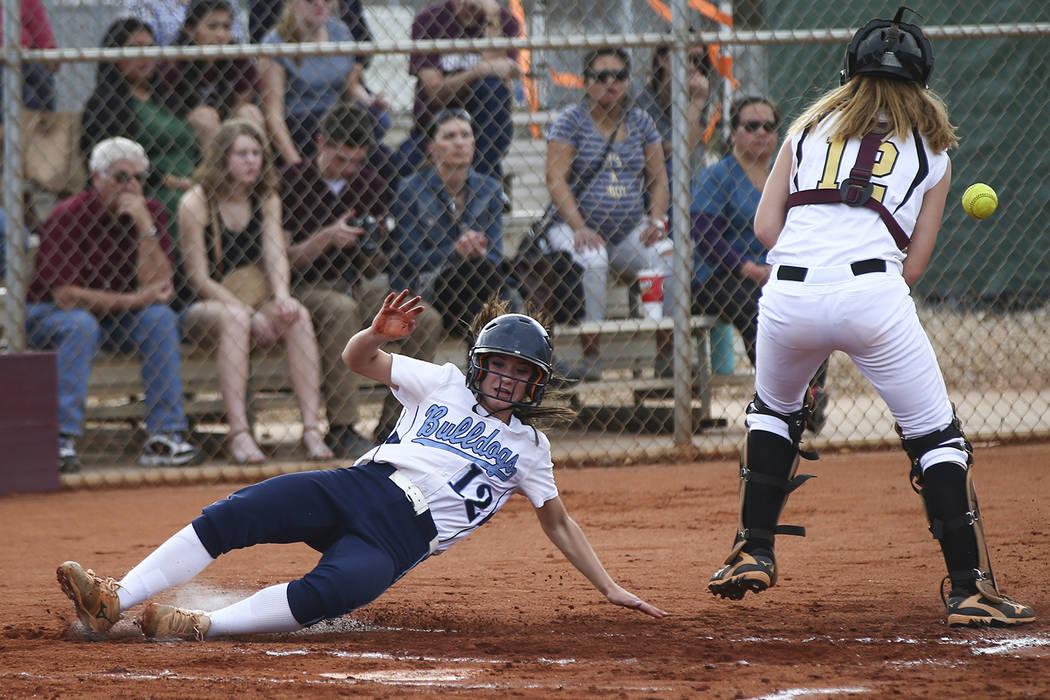 Centennial's Abby Hanley (12) scores a run past Faith Lutheran's Ellie Fried (12) during a softball game at Faith Lutheran in Las Vegas on Tuesday, March 13, 2018. Centennial won 14-1. Chase Steve ...