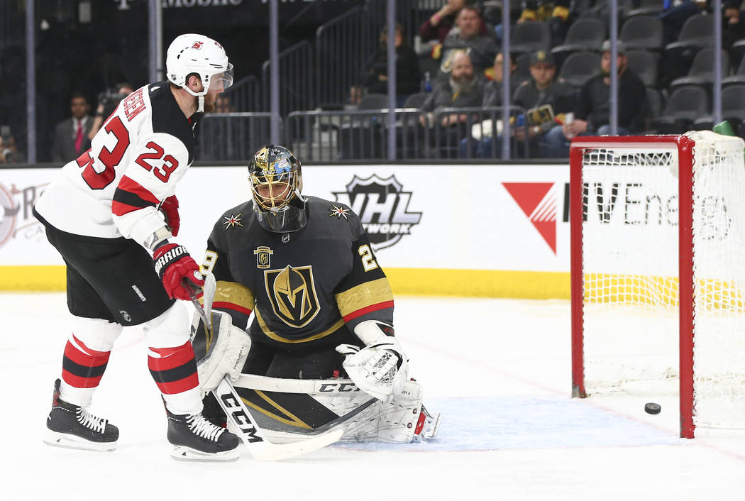 Golden Knights goaltender Marc-Andre Fleury (29) reacts after getting scored on by New Jersey Devils right wing Stefan Noesen (23) during the second period of an NHL hockey game at T-Mobile Arena  ...