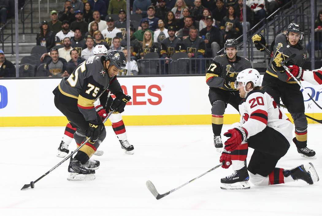 Golden Knights right wing Ryan Reaves (75) lines up a shot as New Jersey Devils center Blake Coleman (20) defends during the first period of an NHL hockey game at T-Mobile Arena in Las Vegas on We ...