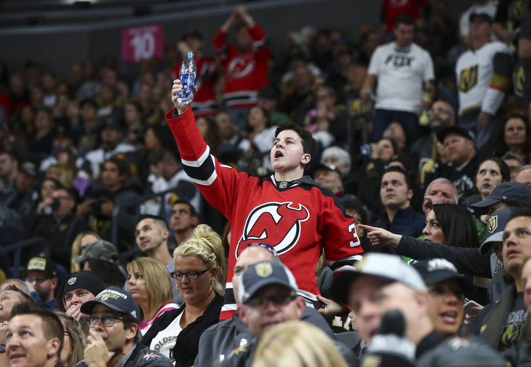 A New Jersey Devils fan celebrates the team's first goal against the Golden Knights during the first period of an NHL hockey game at T-Mobile Arena in Las Vegas on Wednesday, March 14, 2018. Chase ...