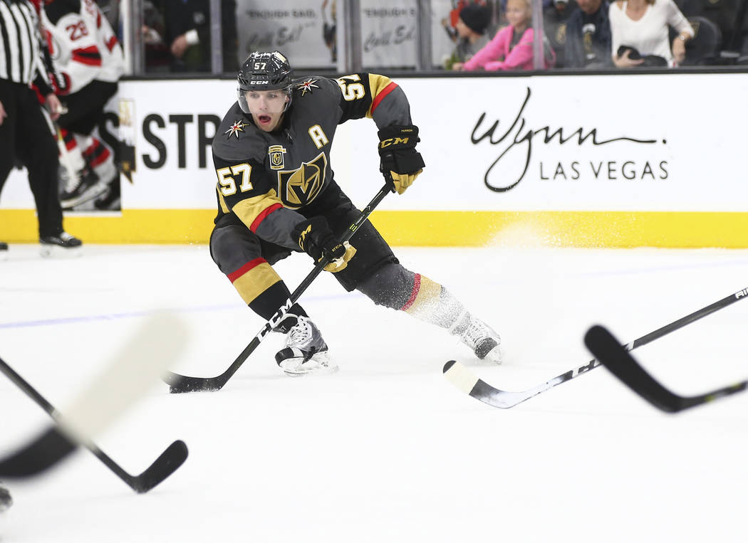 Golden Knights left wing David Perron (57) moves the puck against the New Jersey Devils during the first period of an NHL hockey game at T-Mobile Arena in Las Vegas on Wednesday, March 14, 2018. C ...