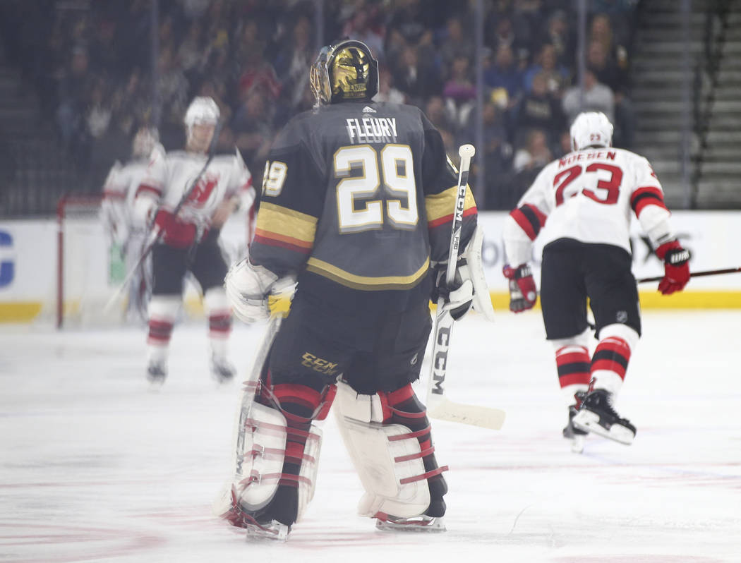 Golden Knights goaltender Marc-Andre Fleury (29) heads to the bench after allowing four goals in the first two periods of an NHL hockey game against the New Jersey Devils at T-Mobile Arena in Las  ...