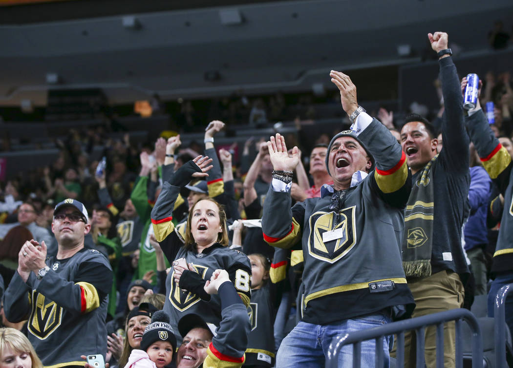 Golden Knights fans celebrate the team's first goal against the New Jersey Devils during the second period of an NHL hockey game at T-Mobile Arena in Las Vegas on Wednesday, March 14, 2018. Chase  ...