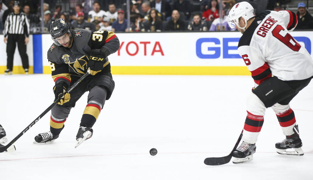 Golden Knights right wing Tomas Hyka (38) and New Jersey Devils defenseman Andy Greene (6) go after the puck during the third period of an NHL hockey game at T-Mobile Arena in Las Vegas on Wednesd ...