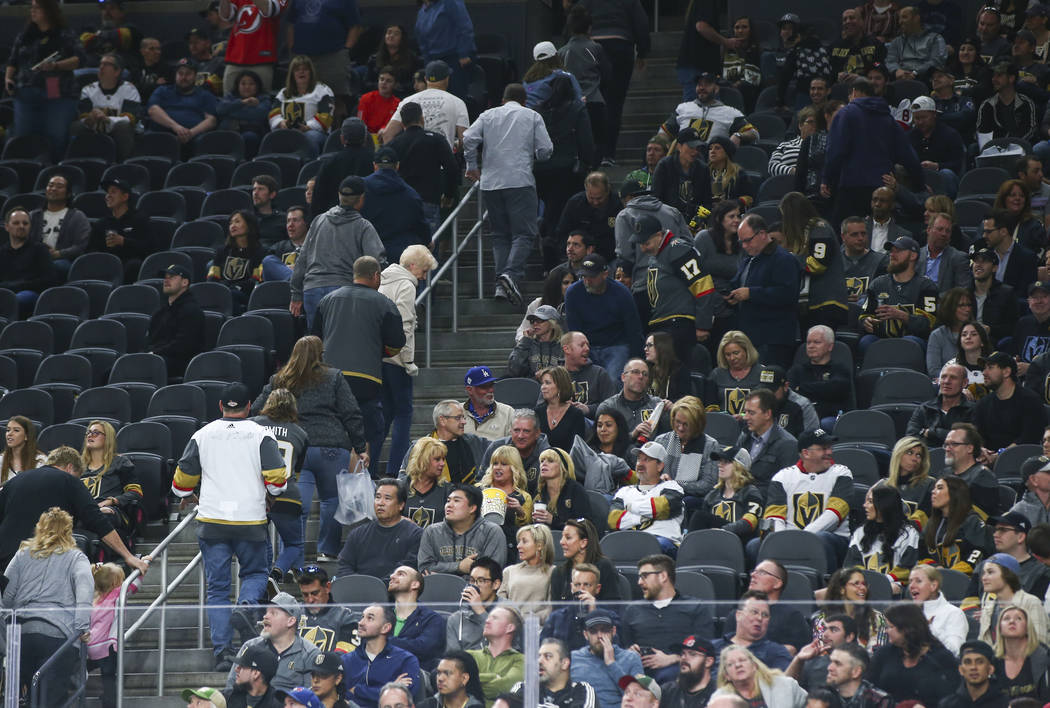 Golden Knights fans leave their seats with nearly 10 minutes left in the third period as the New Jersey Devils maintain a dominant lead during an NHL hockey game at T-Mobile Arena in Las Vegas on  ...