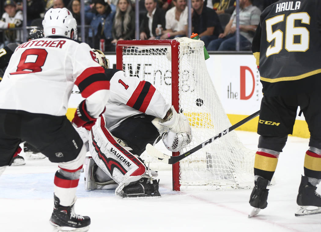 The Golden Knights score against New Jersey Devils goaltender Keith Kinkaid (1) during the third period of an NHL hockey game at T-Mobile Arena in Las Vegas on Wednesday, March 14, 2018. The New J ...