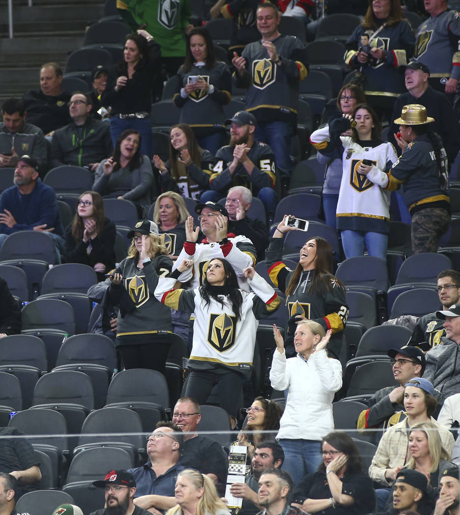 Golden Knights fans celebrate the team's third goal against the New Jersey Devils during the third period of an NHL hockey game at T-Mobile Arena in Las Vegas on Wednesday, March 14, 2018. The New ...
