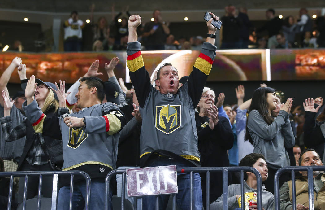 Golden Knights fans celebrate the second goal against the New Jersey Devils during the second period of an NHL hockey game at T-Mobile Arena in Las Vegas on Wednesday, March 14, 2018. Chase Steven ...