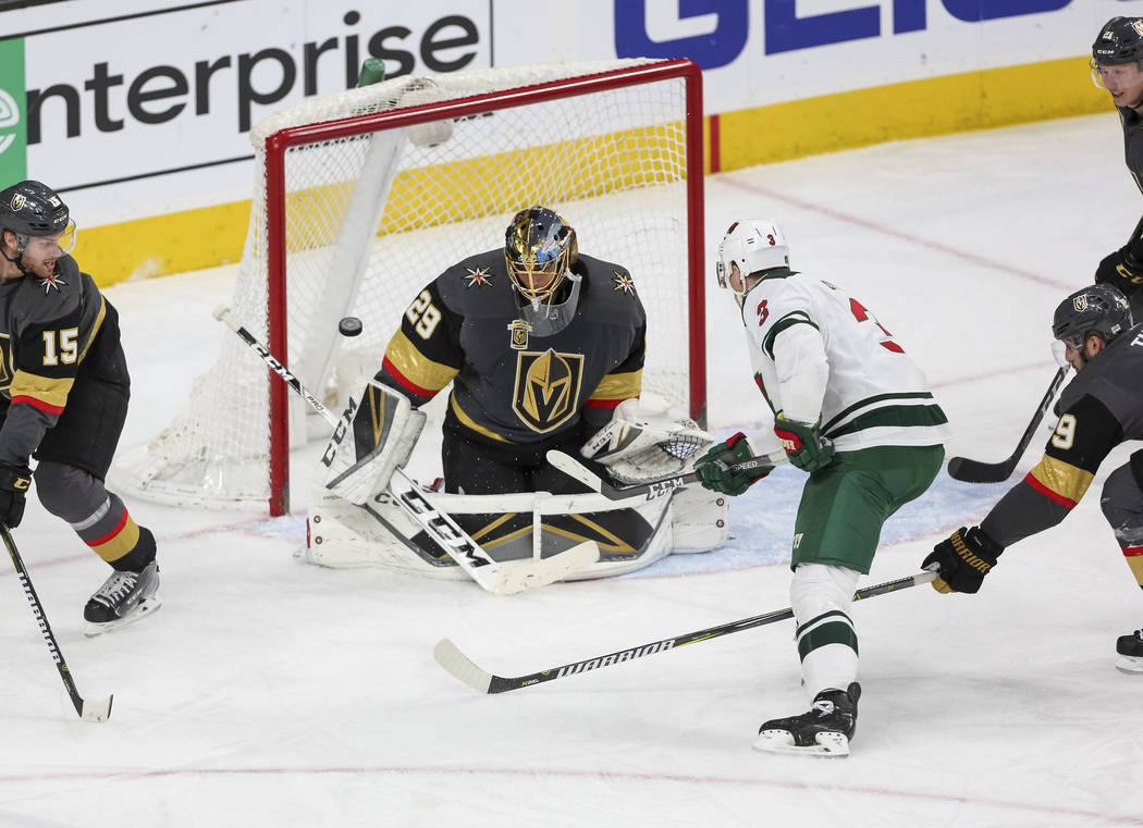 Minnesota Wild center Charlie Coyle (3) scores a goal on Vegas Golden Knights goaltender Marc-Andre Fleury (29) during the second period of an NHL hockey game between the Vegas Golden Knights and  ...