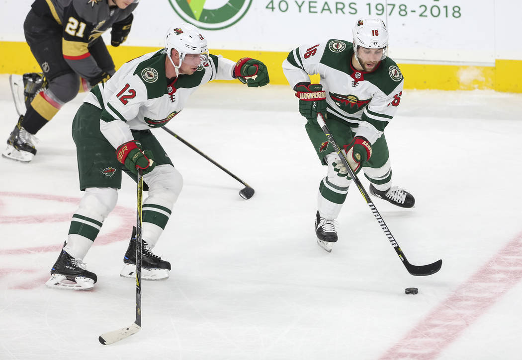Minnesota Wild left wing Jason Zucker (16) controls the puck as Wilds center Eric Staal (12) follows during the second period of an NHL hockey game between the Vegas Golden Knights and the Minneso ...