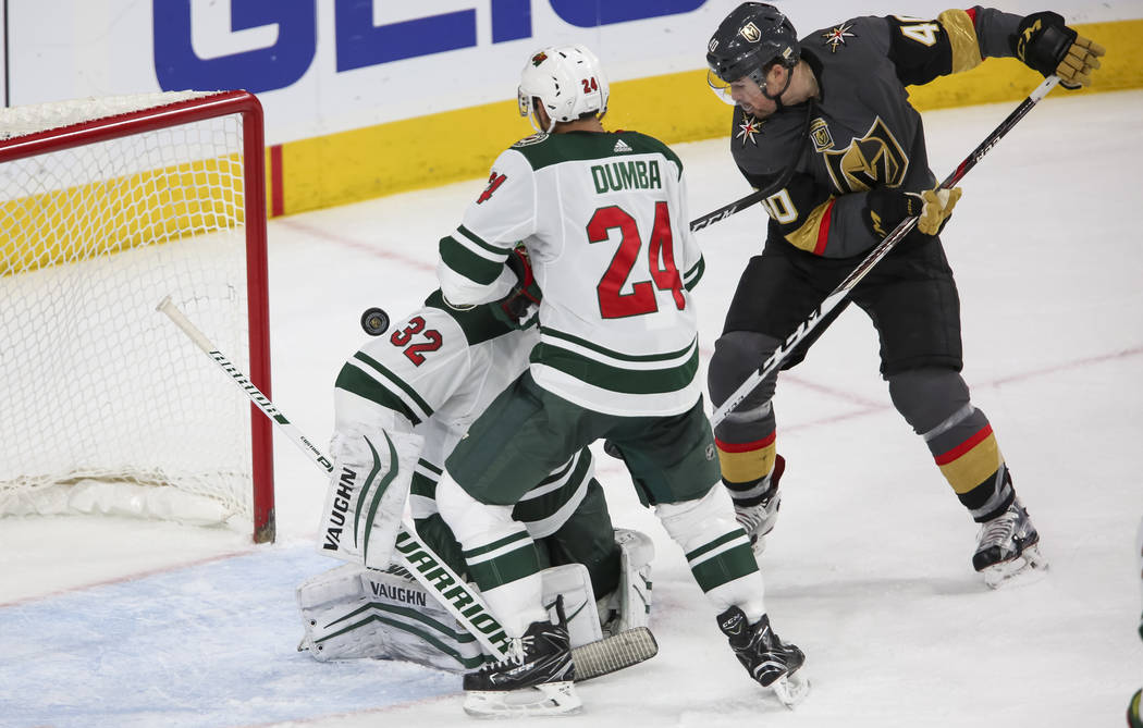 Vegas Golden Knights center Ryan Carpenter (40), right, chips in the puck for a goal past Minnesota Wild defenseman Matt Dumba (24) and goaltender Alex Stalock (32) during the third period of an N ...