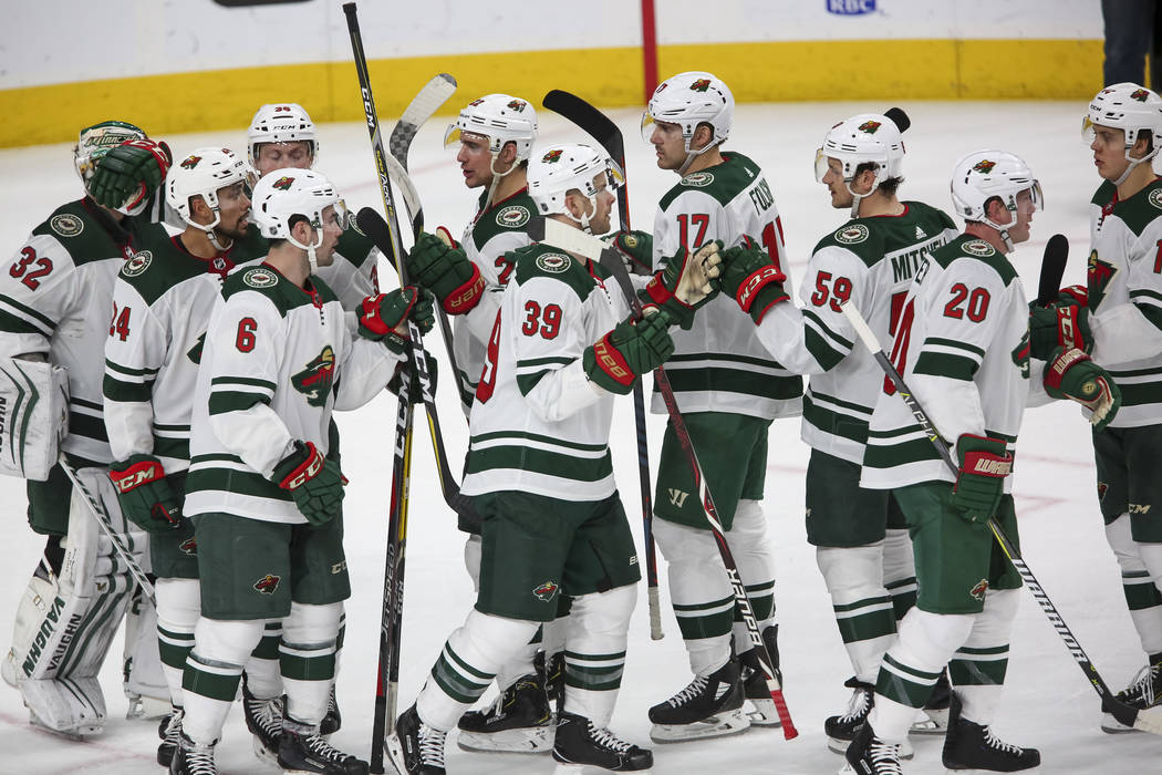 Minnesota Wild players celebrate their 4-2 victory over the Vegas Golden Knights following an NHL hockey game at the T-Mobile Arena in Las Vegas on Friday, March 16, 2018. Richard Brian Las Vegas  ...