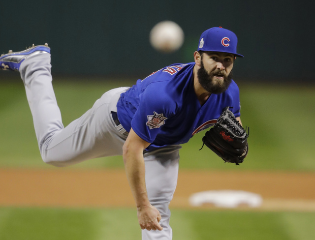 Chicago Cubs starting pitcher Jake Arrieta throws during the first inning of Game 2 of the Major League Baseball World Series against the Cleveland Indians Wednesday, Oct. 26, 2016, in Cleveland.  ...