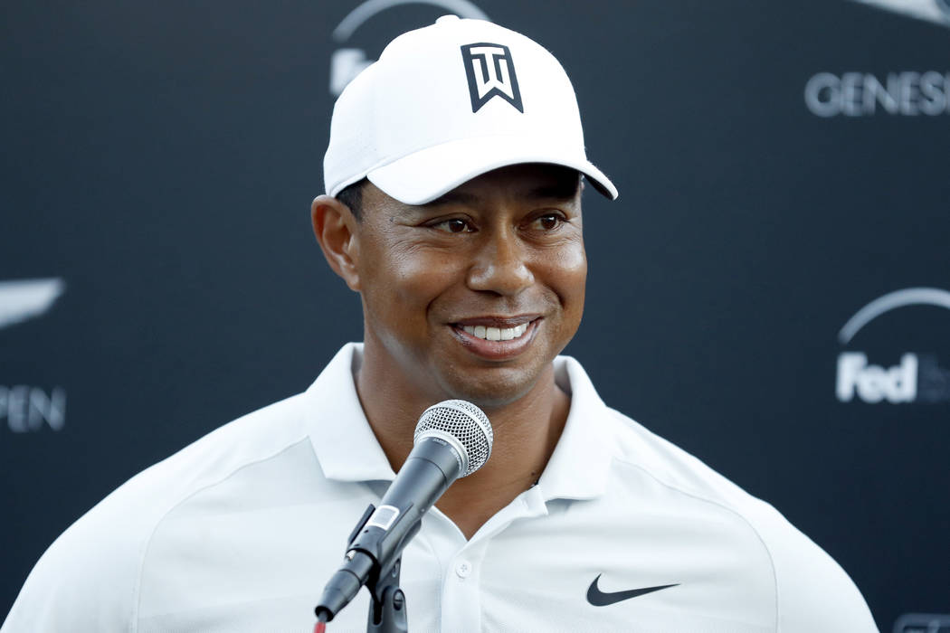 In this Feb. 16, 2018, file photo, Tiger Woods talks to reporters following his second round of the Genesis Open golf tournament at Riviera Country Club in the Pacific Palisades area of Los Angele ...