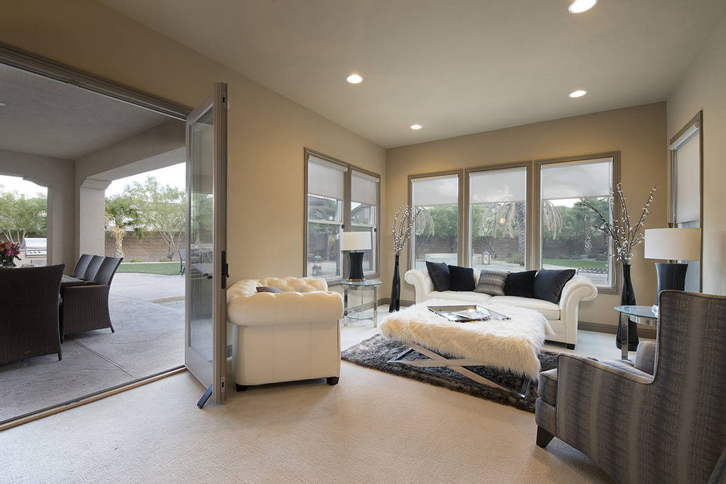 A sitting area in the game room opens to the patio. (Synergy/Sotheby's International Realty)