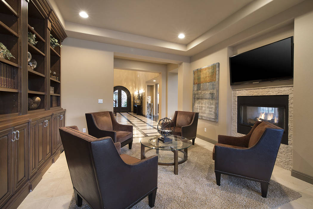 The home features a library and sitting area. (Synergy/Sotheby's International Realty)