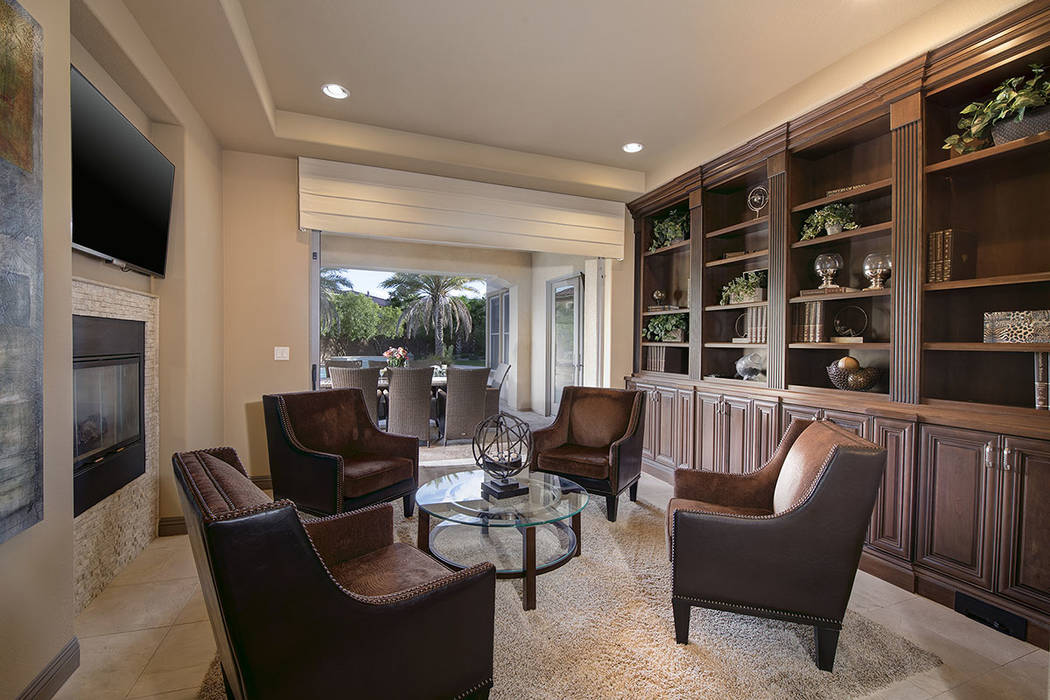 The library opens to the patio. (Synergy/Sotheby's International Realty)