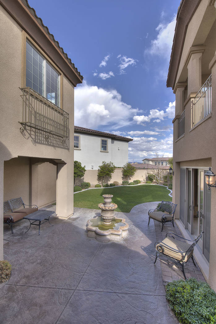 The home has a courtyard. (Synergy/Sotheby's International Realty)