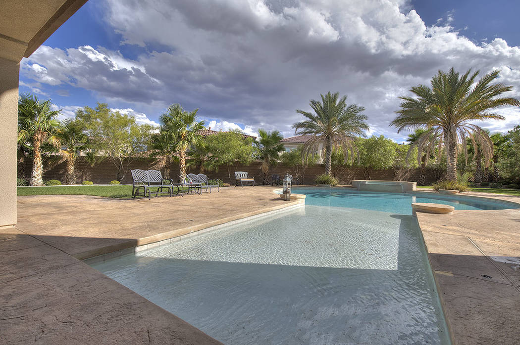 Outside, is a pool, spa and our door kitchen. (Synergy/Sotheby's International Realty)