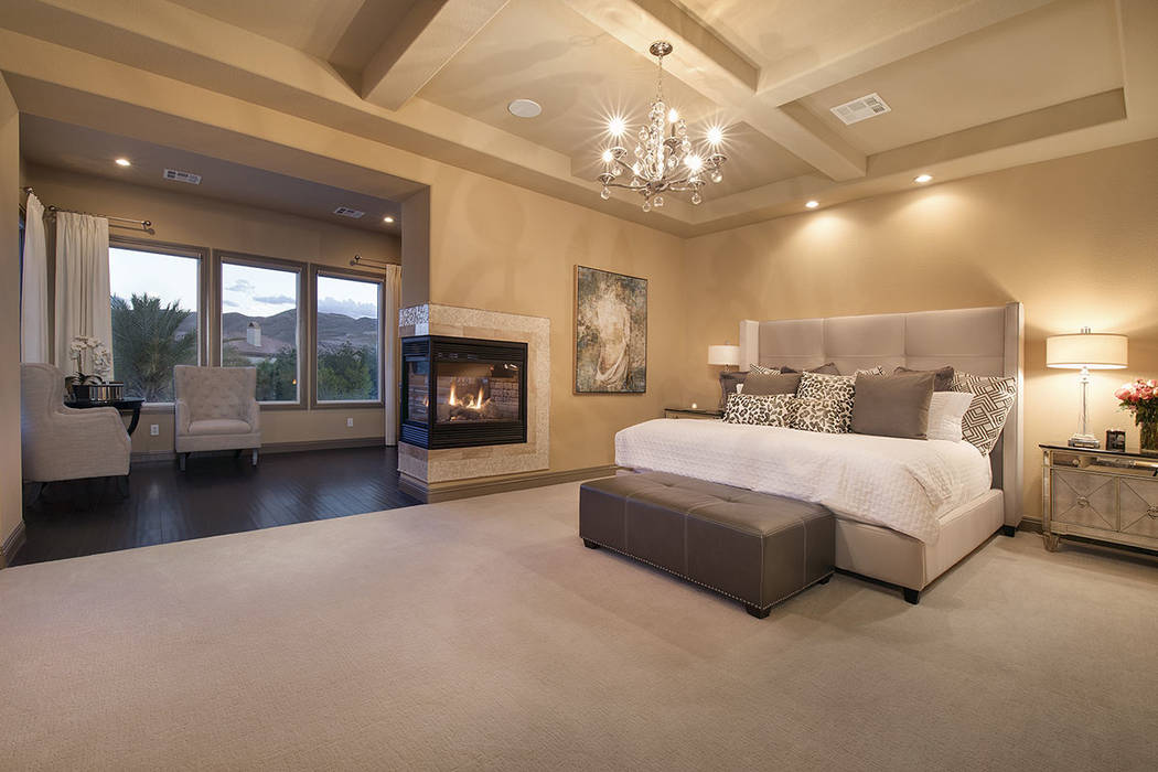 The master suite features a three-sided fireplace. (Synergy/Sotheby's International Realty)