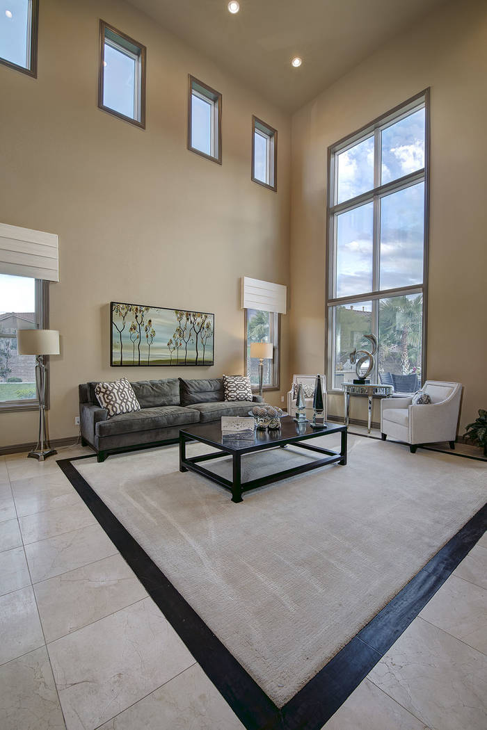 The family room features large windows and high ceilings. (Synergy/Sotheby's International Realty)