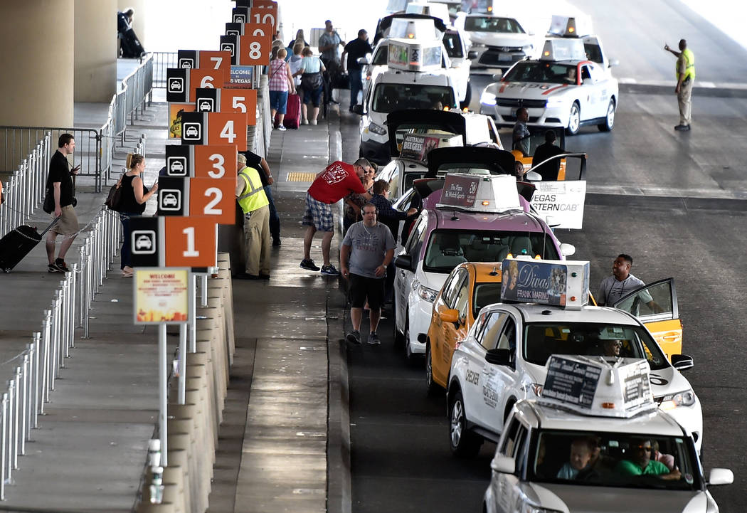 Taxi cabs line up for their passengers at Terminal 3 at McCarran International Airport Wednesday, Sept. 21, 2016, in Las Vegas. (David Becker/Las Vegas Review-Journal)