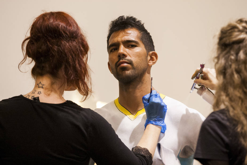 Las Vegas Lights defender Miguel Garduno has the design for the away jersey painted on him by Skin City Body Painting at the Las Vegas Lights FC season kickoff party at the Plaza in downtown Las V ...