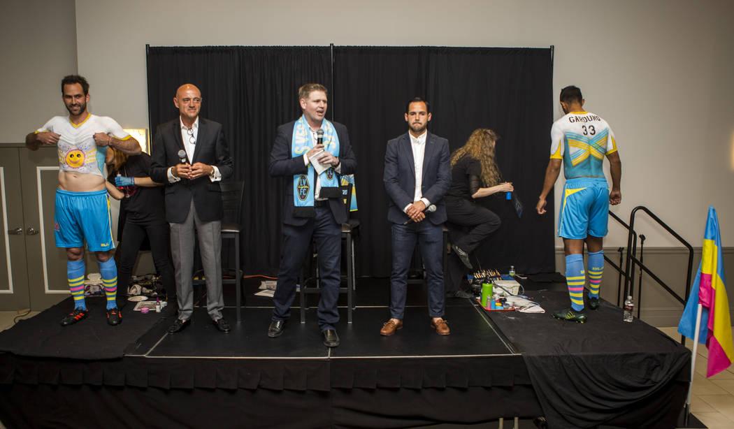 Las Vegas Lights CEO Brett Lashbrook speaks alongside Technical Director Jose Luis Sanchez Sola, center left, and Head Coach Isidro Sanchez, center right, while players Juan Carlos Garcia, far lef ...