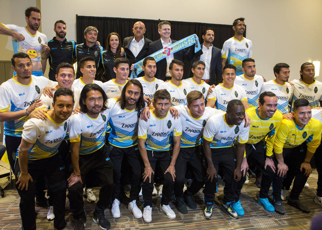 Players and coaches come together for a group photo at the Las Vegas Lights FC season kickoff party at the Plaza in downtown Las Vegas on Wednesday, March 14, 2018.  Patrick Connolly Las Vegas Rev ...