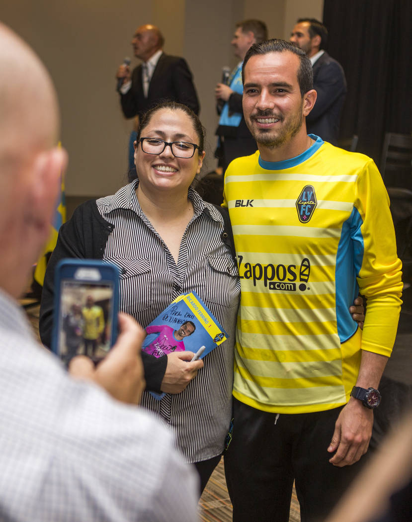 A fan has her photo taken with goalkeeper Ricardo Ferrino at the Las Vegas Lights FC season kickoff party at the Plaza in downtown Las Vegas on Wednesday, March 14, 2018.  Patrick Connolly Las Veg ...